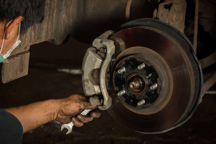Repair Brake, Brake disk and caliper assembly on a modern car about to be replaced.